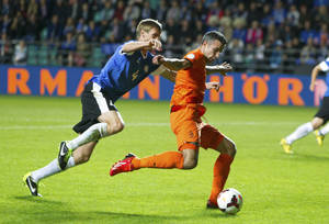 Photo - Netherland's Robin van Persie, right, vies for the ball with Estonia's Raio Piiroja during their World Cup group D qualifying soccer match in Tallinn, Estonia, Friday Sept. 6, 2013. (AP Photo/Liis Treimann)
