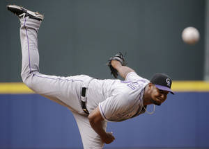 Photo - Colorado Rockies starting pitcher Juan Nicasio throws in the first inning of a baseball game against the Atlanta Braves, Saturday, May 24, 2014, in Atlanta. (AP Photo/David Goldman)