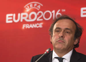 Photo -   UEFA President and former French soccer star Michel Platini listens to a reporter during a press conference after a meeting on the preparartions for the European Championship 2016 in France at the headquarters of the French Football Federation in Paris, Tuesday, Oct. 23, 2012. (AP Photo/Michel Euler)