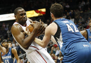 Photo - Atlanta Hawks forward Elton Brand and Minnesota Timberwolves Kevin Love, right, struggle for a rebound in the first half of an NBA basketball game, Saturday, Feb. 1, 2014, in Atlanta. (AP Photo/John Bazemore)