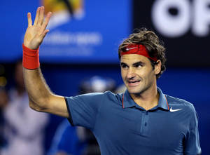 Photo - FILE  - In this Jan. 20, 2014 file photo,  Roger Federer of Switzerland celebrates after defeating Jo-Wilfried Tsonga of France during their fourth round match at the Australian Open tennis championship in Melbourne, Australia.  Federer, winner of 17 Grand Slams, faces Wimbledon champion Andy Murray  at the Australian Open quarterfinal Wednesday.(AP Photo/Aaron Favila, File)