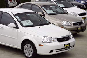 Photo -  Unsold 2007 Forenza sedans outside a Suzuki dealership are seen in the northwest Denver suburb of Wheat Ridge, Colo.     AP File Photo <strong>David Zalubowski -  AP </strong>