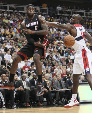 Photo -   Miami Heat forward LeBron James (6) passes off the ball as Washington Wizards center Emeka Okafor (50) defends during the first half of an NBA preseason basketball game, Wednesday, Oct. 24, 2012, in Kansas City, Mo. (AP Photo/Colin E. Braley)