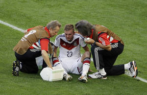Photo - Germany's Christoph Kramer gets assistance during the World Cup final soccer match between Germany and Argentina at the Maracana Stadium in Rio de Janeiro, Brazil, Sunday, July 13, 2014. (AP Photo/Themba Hadebe)