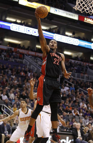 Photo - Toronto Raptors' Rudy Gay (22) drives to the basket against the Phoenix Suns during the second half of an NBA basketball game Friday, Dec. 6, 2013 in Phoenix. (AP Photo/Ralph Freso)