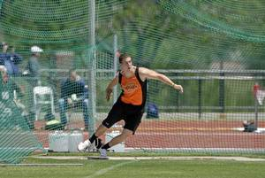 photo - Andrew Hudson has joined the Cowboys track team throwing the discus. Photo Provided
