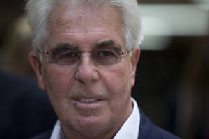 Photo - British public relations guru Max Clifford pauses to pose for members of the media as he leaves his trial at Southwark Crown Court in London, Monday, April 28, 2014. Leading British public relations agent Clifford on Monday was found guilty of eight counts of indecent assault on women and girls. (AP Photo/Matt Dunham)