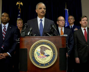 Photo -   U.S. Attorney General Eric Holder, center, arrives at a press conference followed by Acting Associate Attorney General Tony West, far left, and lead by Assistant Attorney General for the Criminal Division Lanny A. Breuer, top right, to speak about the 2010 Gulf Oil Spill settlement and criminal penalties in New Orleans, La. Thursday, Nov. 15, 2012. Holder said the settlement and indictments aren't the end of federal authorities' efforts and that the criminal investigation is continuing. Holder says much of the money BP has agreed to pay will be used to restore the environment in the Gulf. (AP Photo/Matthew Hinton)