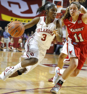 photo - OU: Oklahoma's Aaryn Ellenberg (3) drives to the basket as Marist's Leanne Ockenden (11) defends during the women's college basketball game between the University of Oklahoma and Marist at Lloyd Noble Center in Norman, Okla.,  Sunday,Dec. 2, 2012. Photo by Sarah Phipps, The Oklahoman