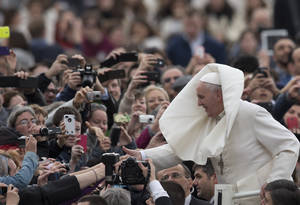 Photo - Pope Francis is greeted by the faithful as he tours St. Peter's Square at the Vatican, prior to his general audience, Wednesday, Feb. 19, 2014. (AP Photo/Alessandra Tarantino)