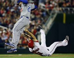 Photo -   Washington Nationals third baseman Ryan Zimmerman makes the tag on Los Angeles Dodgers' Adrian Gonzalez (23) during the third inning of the second baseball game of a doubleheader at Nationals Park, Wednesday, Sept. 19, 2012, in Washington. The Dodgers won the second game 7-6. (AP Photo/Alex Brandon)