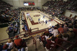 Photo - OU: Fans watch from the stands during a college basketball game between the University of Oklahoma and Texas A&M Corpus Christi at McCasland Field House in Norman, Okla., Monday, Dec. 31, 2012.  Photo by Garett Fisbeck, For The Oklahoman