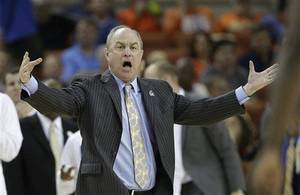 Photo - Ben Howland reacts to a call during the NCAA tournament. AP Photo