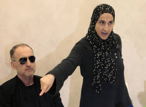 Photo - The mother of the two Boston bombing suspects, Zubeidat Tsarnaeva, with the suspects' father Anzor Tsarnaev, left, speaks at a news conference in Makhachkala, the southern Russian province of Dagestan, Thursday, April 25, 2013. The father of the two Boston bombing suspects said Thursday that he is leaving Russia for the United States in the next day or two, but their mother said she was still thinking it over. (AP Photo/Musa Sadulayev)