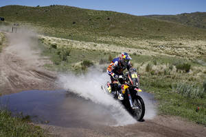 Photo - Marc Coma, of Spain, rides his KTM motorcycle through a creek during the first stage of the Dakar Rally between the cities of Rosario and San Luis, Argentina, Sunday, Jan. 5, 2014. (AP Photo/Victor R. Caivano)