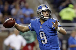 Photo - FILE - In this Aug. 9, 2013 file photo, Detroit Lions quarterback Matthew Stafford throws during a preseason NFL football game against the New York Jets in Detroit. It's remarkable to think that Stafford has more to prove after throwing for over 10,000 yards over the last two seasons, but the Detroit quarterback couldn't prevent an eight-game losing streak to end last season. (AP Photo/Paul Sancya)