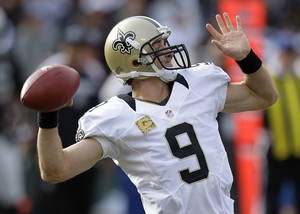 Photo -   New Orleans Saints quarterback Drew Brees drops back to pass during the second quarter of an NFL football game against the Oakland Raiders in Oakland, Calif., Sunday, Nov. 18, 2012. (AP Photo/Ben Margot)