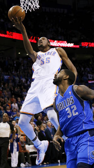 Photo - Oklahoma City's Kevin Durant (35) shoots against Dallas' O.J. Mayo (32) during an NBA basketball game between the Oklahoma City Thunder and the Dallas Mavericks at Chesapeake Energy Arena in Oklahoma City, Monday, Feb. 4, 2013. Photo by Nate Billings, The Oklahoman
