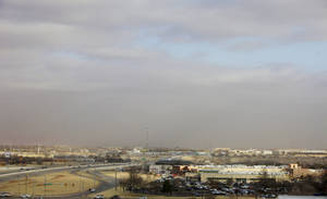 Photo -  Winds whip up a cloud of dust and haze close to the ground as high winds move through Oklahoma City on Thursday morning. Photo by Paul B. Southerland, The Oklahoman  <strong>PAUL B. SOUTHERLAND -   </strong>