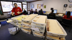 photo - Workers begin to validate returned ballots at the headquarters of the union for Boeing Co.'s engineers and technical workers, Tuesday, Feb. 19, 2013, in Tukwila, Wash. Members of the Society of Professional Engineering Employees in Aerospace (SPEEA) are voting on a contract offer from the company and whether to authorize a strike. The union represents 23,000 employees, mostly in the Puget Sound region. Negotiations began in April and union members rejected one offer in October. The previous contract expired in November. (AP Photo/Elaine Thompson)