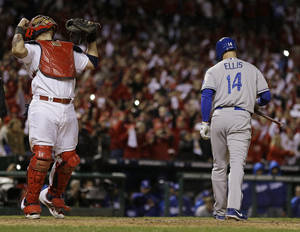 Photo - St. Louis Cardinals catcher Yadier Molina reacts after Los Angeles Dodgers' Mark Ellis strikes out to end Game 6 of the National League baseball championship series Friday, Oct. 18, 2013, in St. Louis. The Cardinals won 9-0 to win the series. (AP Photo/Jeff Roberson)