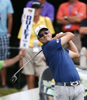 Photo - Zach Johnson watches his drive off the 18th tee during the second round of the 2014 John Deere Classic golf tournament at TPC Deere Run in Silvis, Ill., Friday, July 11, 2014. (AP Photo/Charles Rex Arbogast)