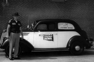 Photo - Trooper Ray Jordan of Seminole, stands next to a 1937 Ford, the Oklahoma Highway Patrol's first car. Jordan was returning from showing off the car at an exhibition in 1966 when he used it to pull over a suspected drunk driver. <strong>PARKS DRUG - PARKS DRUG</strong>