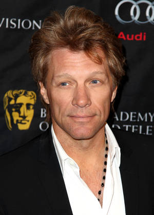 Photo - Jon Bon Jovi arrives at the BAFTA Awards Season Tea Party at The Four Seasons Hotel on Saturday, Jan. 12, 2013, in Los Angeles. (Photo by Matt Sayles/Invision/AP)