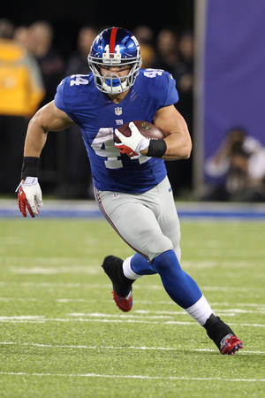 Photo - New York Giants' Peyton Hillis (44) rushes during the second half of an NFL football game against the Minnesota Vikings Monday, Oct. 21, 2013 in East Rutherford, N.J. (AP Photo/Peter Morgan)