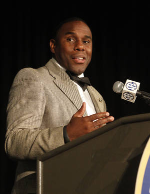 Photo - Vanderbilt Coach Derek Mason speaks to media at SEC media days on Monday, July 14, 2014, in Hoover, Ala. (AP Photo/Butch Dill)