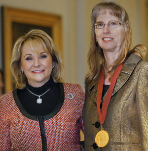 Photo - Jeanine Berrong receives the Arts in Education Award from Gov. Mary Fallin during the 38th Annual Governor's Arts Awards at the Oklahoma State Capitol in Oklahoma City, Okla. on Wednesday, Nov. 13, 2013. Photo by Chris Landsberger, The Oklahoman