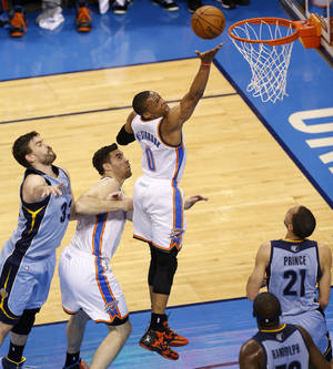 Photo - Oklahoma City's Russell Westbrook (0) goes to the basket between Nick Collison (4), Memphis' Marc Gasol (33), Tayshaun Prince (21), and Zach Randolph during Game 5 in the first round of the NBA playoffs between the Oklahoma City Thunder and the Memphis Grizzlies at Chesapeake Energy Arena in Oklahoma City, Tuesday, April 29, 2014. Photo by Nate Billings, The Oklahoman