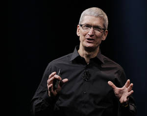 In this Wednesday, Sept. 12, 2012 photo, Apple CEO Tim Cook speaks during an introduction of the new iPhone 5 in San Francisco. Cook is scheduled to testify on Capitol Hill Tuesday May 21, 2013, to explain the company's tax strategy, which a Senate subcommittee says lets it avoid paying billions of dollars in taxes. (AP Photo/Eric Risberg, File)