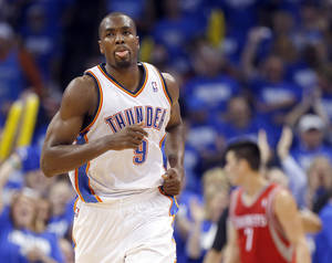Photo - Oklahoma City's Serge Ibaka (9) celebrates during Game 1 in the first round of the NBA playoffs between the Oklahoma City Thunder and the Houston Rockets at Chesapeake Energy Arena in Oklahoma City, Sunday, April 21, 2013. Photo by Sarah Phipps, The Oklahoman