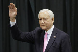 Photo - Sen. Orrin Hatch, R-Utah, waves before addressing a crowd during the Western Republican Leadership Conference, Friday, April 25, 2014, in Sandy, Utah. Republican U.S. Sen. Ted Cruz, of Texas, is scheduled to headline the final day of a two-day conference in Utah where Republican party leaders from western states are meeting. (AP Photo/Rick Bowmer)