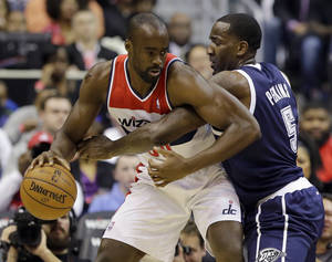 photo - Washington Wizards center Emeka Okafor works against Oklahoma City Thunder center Kendrick Perkins in the first half of an NBA basketball game Monday, Jan. 7, 2013, in Washington. (AP Photo/Alex Brandon)