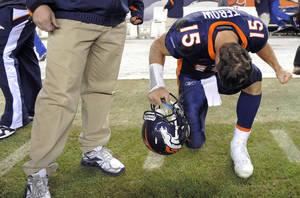 Photo - Denver Broncos quarterback Tim Tebow (15) reacts after kicker Matt Prater (5) kicked a 51-yard field goal to win the game in overtime over the Chicago Bears in an NFL football game, Sunday, Dec. 11, 2011, in Denver. The Broncos won 13-10. (AP Photo/Jack Dempsey) ORG XMIT: COJJ130
