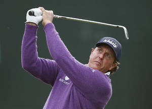 Photo - Phil Mickelson hits his tee shot at the 16th hole during the second round of the Phoenix Open golf tournament Friday, Jan. 31, 2014, in Scottsdale, Ariz. (AP Photo/Ross D. Franklin)