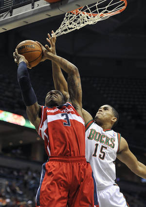photo -   Washington Wizards' Bradley Beal (3) shoots over Milwaukee Bucks' Tobias Harris (15) during the first half of an NBA preseason basketball game, Saturday, Oct. 20, 2012, in Milwaukee. (AP Photo/Jim Prisching)