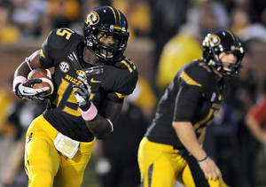 Photo -   FILE - In this Sept., 15 2012, file photo, Missouri wide receiver Dorial Green-Beckham carries the ball during the second quarter of an NCAA college football game against Arizona State in Columbia, Mo. Green-Beckham now has seven catches for 128 yards and a touchdown through five games at Missouri, but says he feels no pressure to perform at a certain level. (AP Photo/L.G. Patterson, File)