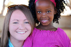 Photo - Dayla Rowland pauses with a new friend she met during a Global Outreach trip to Zambia. Rowland led a team of seven Oklahoma Baptist University students on a mission to the African nation in May.  Photo provided