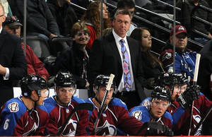 Photo - Colorado Avalanche head coach Patrick Roy looks on against the Nashville Predators during the second period of an NHL hockey game on Friday, Oct. 4, 2013, in Denver. (AP Photo/Jack Dempsey)