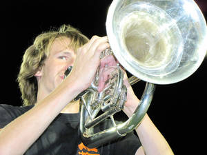 Photo - Tyler James, a sophomore baritone player, performs during a rehearsal at the Putnam City Stadium in  Oklahoma City. Photos by Terry Groover, The Oklahoman
