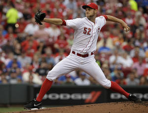 Photo - Cincinnati Reds starting pitcher Tony Cingrani throws against the Los Angeles Dodgers in the first inning of a baseball game, Monday, June 9, 2014, in Cincinnati. (AP Photo/Al Behrman)