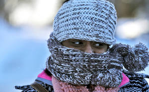 Photo - Nyjaii Williams, of St. Paul, is bundled up against the cold wind, Sunday, Jan. 26, 2014, in St. Paul. (AP Photo/The Star Tribune, Marlin Levison)  MANDATORY CREDIT; ST. PAUL PIONEER PRESS OUT; MAGS OUT; TWIN CITIES TV OUT