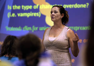 photo - Left: Jennifer Johnson from the University of Oklahoma Writing Center talks to teens about how to create comic book characters.