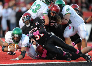 Photo -   Eastern Washington's T.J. Lee III (31) brings down North Dakota's Mitch Sutton, left, during the first half of a Big Sky Conference NCAA college football game on Saturday, Oct. 6, 2012, at Roos Field in Cheney, Wash. (AP Photo/The Spokesman-Review, Tyler Tjomsland)