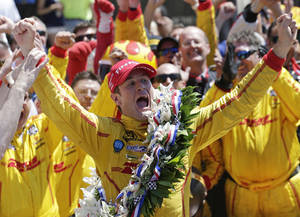 Photo - Ryan Hunter-Reay celebrates winning the 98th running of the Indianapolis 500 IndyCar auto race at the Indianapolis Motor Speedway in Indianapolis, Sunday, May 25, 2014. (AP Photo/AJ Mast)