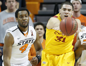 Photo - Oklahoma State's Brian Williams (4) defends on Iowa State Cyclones' Georges Niang (31) during the college basketball game between the Oklahoma State University Cowboys (OSU) and the Iowa State University Cyclones (ISU) at Gallagher-Iba Arena on Wednesday, Jan. 30, 2013, in Stillwater, Okla.  Photo by Chris Landsberger, The Oklahoman