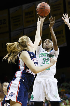 Photo - Notre Dame guard Jewell Loyd (32) shoots over Robert Morris guard Rebeca Navarro (10) during the first half in a first-round game in the NCAA women's college basketball tournament, Saturday, March 22, 2014, in Toledo, Ohio. (AP Photo/Rick Osentoski)